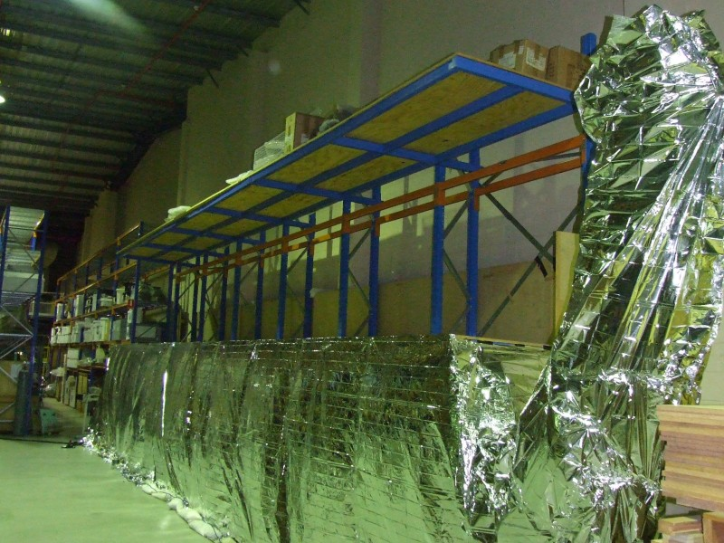 Completed canoe wrapped in foil to maintain steady temperature throughout treatment